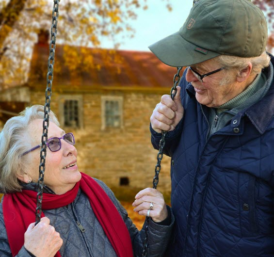 Image of elderly couple swinging from The Compounding Lab in Dayton, Ohio website.
