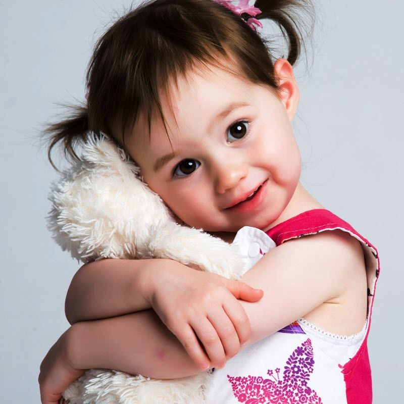 Image of toddler girl hugging a stuffed animal  from The Compounding Lab in Dayton, Ohio.
